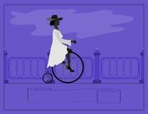 Νέα κυρία και αναδρομικό ποδήλατο Στοκ Φωτογραφίες