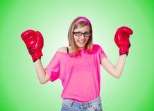 Νέα κυρία με τα εγκιβωτίζοντας γάντια στο λευκό Στοκ Φωτογραφία