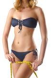 Νέα κυρία με το centimetr - έννοια απώλειας βάρους Στοκ Εικόνες