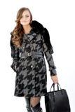 Νέα κυρία στο παλτό Στοκ Φωτογραφία