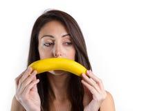 Νέα λυπημένη γυναίκα με την μπανάνα Στοκ Εικόνα