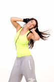Νέα μουσική ακούσματος brunette Στοκ φωτογραφία με δικαίωμα ελεύθερης χρήσης