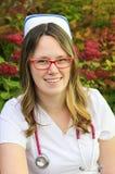 Νέα νοσοκόμα με την ΚΑΠ Στοκ Φωτογραφία