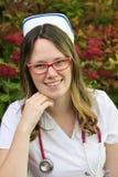 Νέα νοσοκόμα με την ΚΑΠ Στοκ Εικόνα