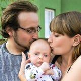 Νέα οικογένεια με το μωρό Στοκ Εικόνα