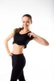 Νέα προκλητική αθλητική γυναίκα μαύρο sportswear - που απομονώνεται στο μόριο Στοκ Φωτογραφίες