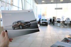 Νέα ρωσική ΑΚΤΙΝΑ X Lada αυτοκινήτων κατά τη διάρκεια της παρουσίασης στις 14 Φεβρουαρίου 2016 στην αυτοκινητική αίθουσα εκθέσεως Στοκ φωτογραφία με δικαίωμα ελεύθερης χρήσης