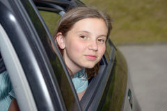 Νέα συνεδρίαση έφηβη σε ένα αυτοκίνητο Στοκ Εικόνες