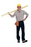 Νέα φέρνοντας ξυλεία οικοδόμων στοκ φωτογραφίες