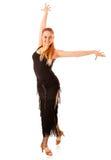Νέα χορεύοντας γυναίκα με το μαύρο φόρεμα στοκ φωτογραφία