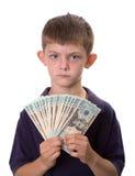 Νέα χρήματα μετρητών εκμετάλλευσης αγοριών με το σοβαρό βλέμμα Στοκ Φωτογραφίες