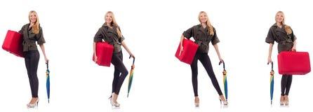 Νέα όμορφη γυναίκα με τη βαλίτσα και ομπρέλα που απομονώνεται στο whi στοκ φωτογραφίες με δικαίωμα ελεύθερης χρήσης