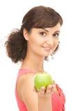 Νέα όμορφη γυναίκα με το πράσινο μήλο Στοκ Εικόνες