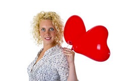 Νέα ballons καρδιών εκμετάλλευσης γυναικών Στοκ Εικόνες