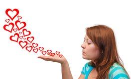 Νέες φυσώντας καρδιές γυναικών Στοκ εικόνες με δικαίωμα ελεύθερης χρήσης