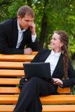 Νέοι επιχειρηματίες με το lap-top Στοκ Εικόνα