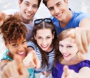 Νέοι που δείχνουν σε σας στοκ εικόνα