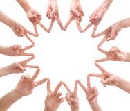 Νέοι που κάνουν τον κύκλο με τα χέρια τους Στοκ Εικόνα