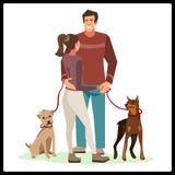 Νέοι που στέκονται με τα σκυλιά τους απεικόνιση αποθεμάτων