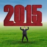 Νέος αριθμός 2015 ανύψωσης επιχειρηματιών Στοκ φωτογραφία με δικαίωμα ελεύθερης χρήσης