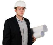 Νέος αρχιτέκτονας ή μηχανικός με τα σχεδιαγράμματα Στοκ Φωτογραφία