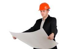 Νέος αρχιτέκτονας ή μηχανικός που μελετά ένα σχέδιο Στοκ Εικόνα