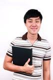 Νέος ασιατικός σπουδαστής με τα βιβλία διαθέσιμα. Στοκ Εικόνες