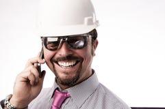 Νέος εκτελεστικός μηχανικός στο τηλέφωνο στοκ εικόνα
