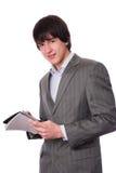Νέος επιχειρηματίας ή σπουδαστής με το σημειωματάριο Στοκ Φωτογραφίες