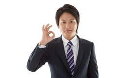 Νέος επιχειρηματίας με ένα ΕΝΤΑΞΕΙ σημάδι Στοκ Εικόνα