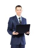 Νέος επιχειρηματίας με ένα lap-top στο άσπρο υπόβαθρο Στοκ εικόνες με δικαίωμα ελεύθερης χρήσης