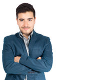 Νέος επιχειρηματίας με τα διασχισμένα όπλα που εξετάζει τη κάμερα Στοκ Εικόνα