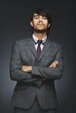 Νέος επιχειρηματίας με την τοποθέτηση Στοκ φωτογραφία με δικαίωμα ελεύθερης χρήσης