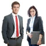 Νέος επιχειρηματίας με το γραμματέα Στοκ Φωτογραφία