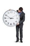 Νέος επιχειρηματίας με το μεγάλο ρολόι Στοκ Φωτογραφίες