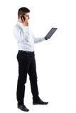 Νέος επιχειρηματίας με το τηλέφωνο και την ταμπλέτα Στοκ Φωτογραφία