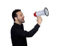 Νέος επιχειρηματίας με Megaphone που πιστοποιεί κάτι Στοκ Εικόνες
