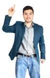 Νέος επιχειρηματίας που δείχνει επάνω στο άσπρο υπόβαθρο Στοκ φωτογραφίες με δικαίωμα ελεύθερης χρήσης