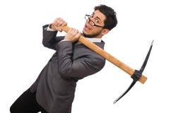 Νέος επιχειρηματίας που κρατά ένα εργαλείο απομονωμένο στο λευκό στοκ εικόνα