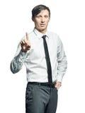 Νέος επιχειρηματίας που παρουσιάζει σημάδι προσοχής Στοκ φωτογραφία με δικαίωμα ελεύθερης χρήσης