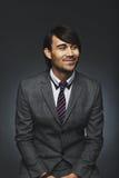 Νέος επιχειρηματίας που φαίνεται μακριά χαμογελώντας Στοκ Εικόνες