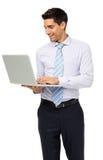Νέος επιχειρηματίας που χρησιμοποιεί το lap-top Στοκ Φωτογραφία