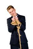 Νέος επιχειρηματίας σε ένα κοστούμι που εμπλέκεται Στοκ εικόνα με δικαίωμα ελεύθερης χρήσης