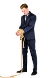 Νέος επιχειρηματίας σε ένα κοστούμι που εμπλέκεται Στοκ φωτογραφία με δικαίωμα ελεύθερης χρήσης