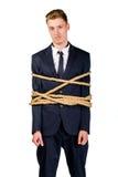 Νέος επιχειρηματίας σε ένα κοστούμι που εμπλέκεται Στοκ Φωτογραφίες