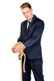 Νέος επιχειρηματίας σε ένα κοστούμι που εμπλέκεται Στοκ Εικόνα