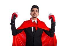 Νέος επιχειρηματίας στα εγκιβωτίζοντας γάντια και το κόκκινο ακρωτήριο superhero Στοκ φωτογραφίες με δικαίωμα ελεύθερης χρήσης