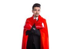 Νέος επιχειρηματίας στα εγκιβωτίζοντας γάντια και το κόκκινο ακρωτήριο superhero Στοκ Φωτογραφίες