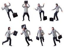Νέος επιχειρηματίας χαρτοφύλακα εκμετάλλευσης κοστουμιών που απομονώνεται στον γκρίζο στο whi Στοκ εικόνα με δικαίωμα ελεύθερης χρήσης