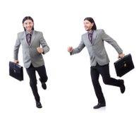 Νέος επιχειρηματίας χαρτοφύλακα εκμετάλλευσης κοστουμιών που απομονώνεται στον γκρίζο στο whi Στοκ Εικόνα